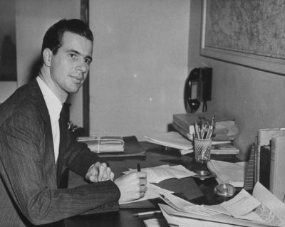Writer John Hersey sitting at his desk w. pen in hand, in office at TIME.  (Photo by Time Life Pictures/Pix Inc./The LIFE Picture Collection/Getty Images)