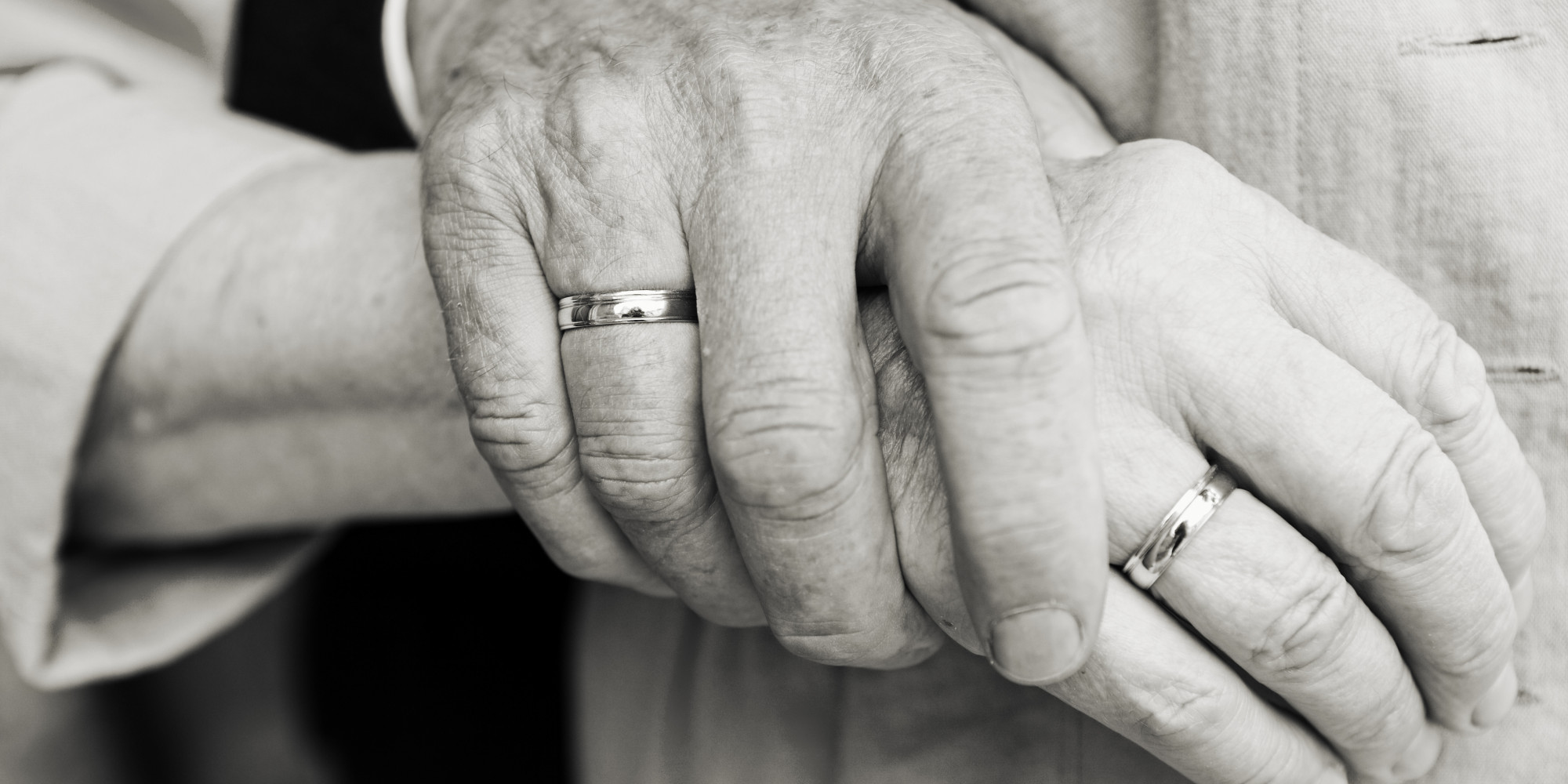 Elderly couple at golden wedding holding hands