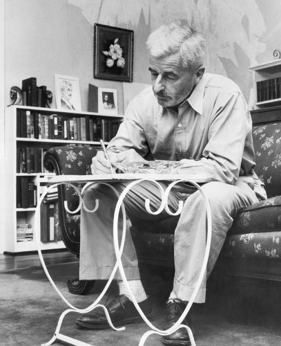 (Original Caption) 5/6/1955- Oxford, MS: Roots of a writer. Author William Faulkner. This is what the birth of literature looks like. Faulkner does most of his writing in this manner, hunched over a glass-topped table with a pen. SEE NOTE
